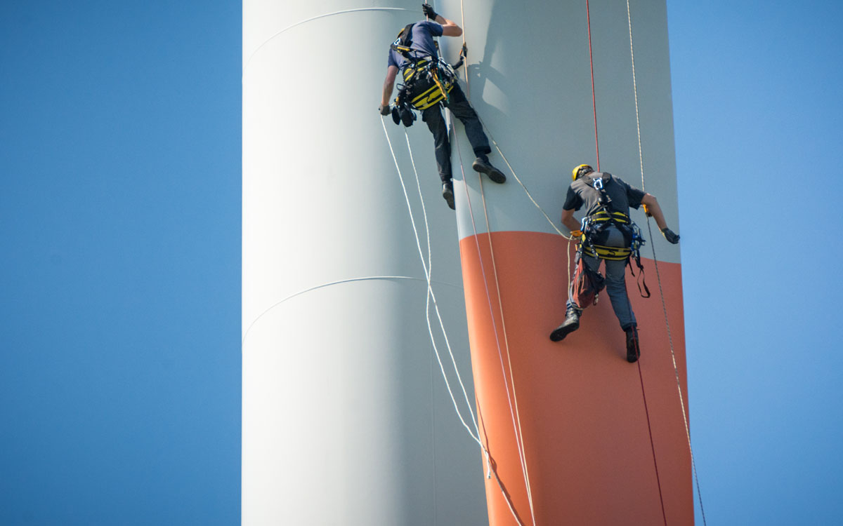 Engineers abseiling down rotor blade